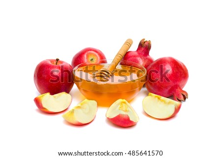 Honey, red apples and garnets on a white background