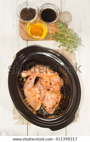 honey, soy sauce, garlic and black pepper marinated chicken leg in a crock pot
