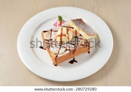 Honey toast with  ice cream,banana and marshmallows. - stock photo
