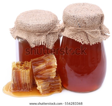 Honey with beehive over white background