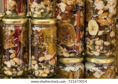 Honey with dried fruits and dried nuts - walnuts, hazelnuts, peanuts, almonds, cashews, plums, cherries, apples, figs and dates.