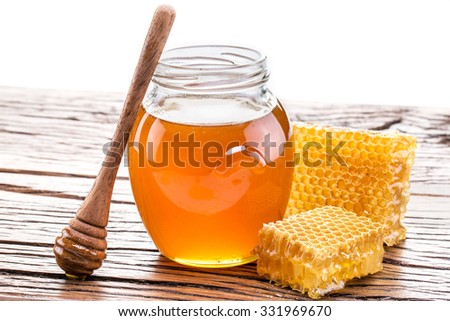 Honeycomb and pot of fresh honey. High-quality picture contains clipping paths. - stock photo