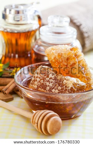 Honeycomb and wooden honey dipper