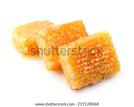 Honeycomb close up on a white background - stock photo