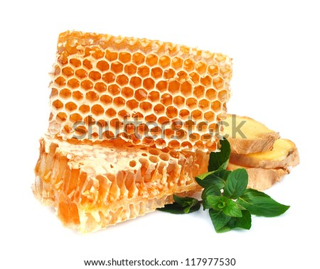 Honeycomb  with mint and ginger close up on the white - stock photo
