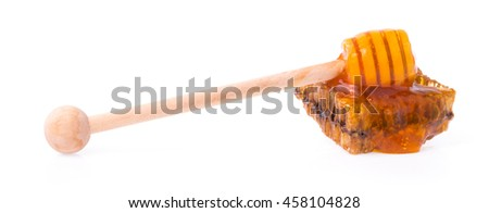 Honeycombs with Wooden dipper for honey isolated on white background - stock photo