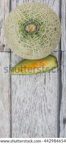 Honeydew fruits over wooden background