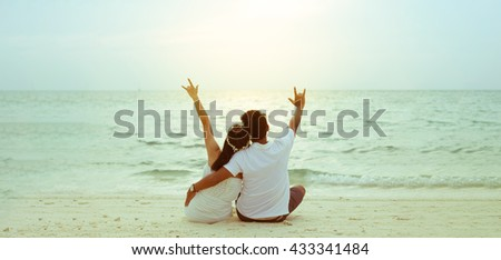 Honeymoon couple romantic prewedding married party, couple sitting on the island beach.