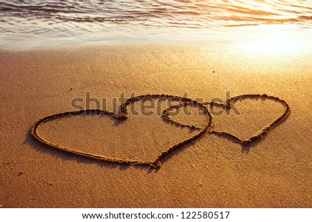 honeymoon or valentine's day greetings on the sand, two hearts