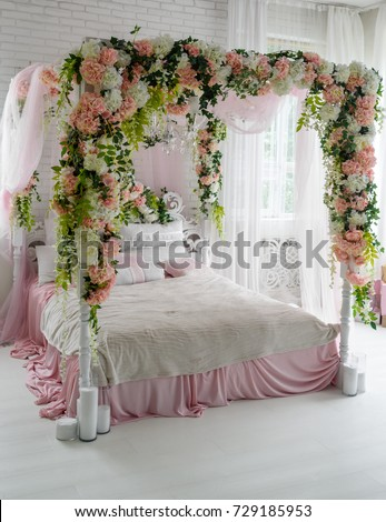 Honeymoon Suite With Canopy Bed, Free Space. Luxurious Wood Canopy Bed With  Flowers And