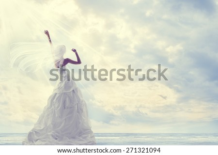 Honeymoon Trip, Bride in Wedding Dress over Blue Sky, Romantic Travel Concept, Looking Ahead - stock photo