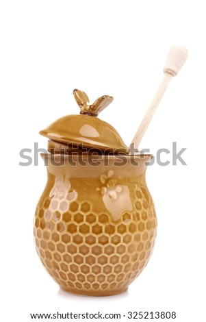 honeypot  and spoon for honey on a white isolated background - stock photo