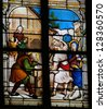 HONFLEUR - FEBRUARY 11: Childhood of Jesus as carpenter in Nazareth on a church window in Honfleur, France  on February 11, 2013. - stock photo