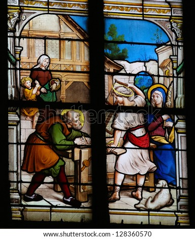 HONFLEUR - FEBRUARY 11: Childhood of Jesus as carpenter in Nazareth on a church window in Honfleur, France  on February 11, 2013.