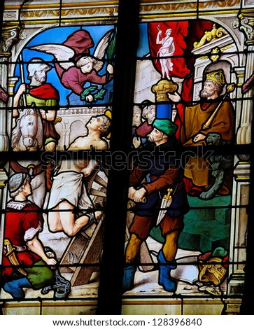 HONFLEUR - FEBRUARY 11: Christian martyr on a stained glass window in Saint Catherines church in Honfleur, France on February 11, 2013.