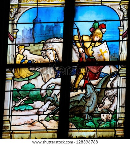 HONFLEUR - FEBRUARY 11: Saint George slaying the dragonon a stained glass window in Saint Catherines church in Honfleur, Calvados, France on February 11, 2013.