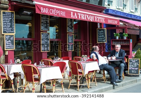 Honfleur, France - May 19, 2012:, Normandy, local people in a bar creperie in the old harbor basin