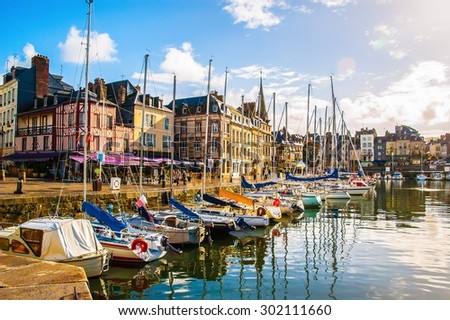 HONFLEUR/FRANCE- OCT 1: Fishing port and boats on Oct 1,2005 in Honfleur, France. The Honfleur is located in the northwest of France.  It is a popular tourist spots. - stock photo