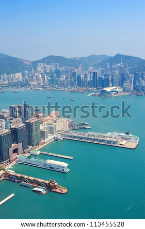 Hong Kong aerial view panorama with urban skyscrapers boat and sea. - stock photo