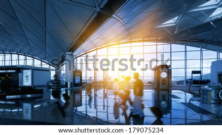 Hong Kong airport, travelers walking
