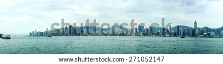 HONG KONG - APR 20, 2015: Panorama of Hong Kong skyline. With a population of 7 million people, Hong Kong is one of the most densely populated areas in the world