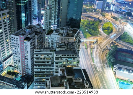 HONG KONG - APRIl 15, 2014: Hong Kong night skyline at night. The city is a major tourist attraction with more than 30 million visitors every year. - stock photo