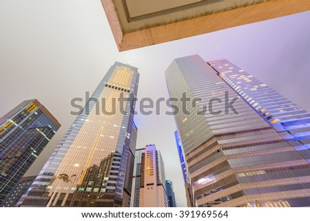 HONG KONG - APRIL 7, 2014: Hong Kong night skyline. The city attracts more than 30 million people annually. - stock photo