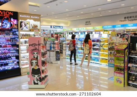 HONG KONG - APRIL 03, 2015: New Town Plaza interior. New Town Plaza is a shopping mall in the town centre of Sha Tin in Hong Kong. Developed by Sun Hung Kai Properties. - stock photo
