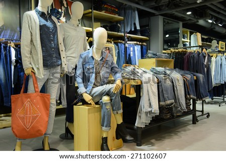 HONG KONG - APRIL 03, 2015: New Town Plaza interior. New Town Plaza is a shopping mall in the town centre of Sha Tin in Hong Kong. Developed by Sun Hung Kai Properties.
