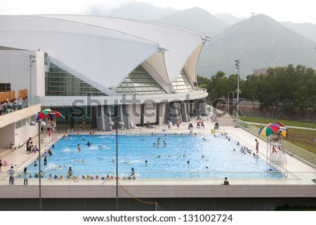 HONG KONG - APRIL 10: Public swimming pool in Hong Kong on April 10 2011. Hong Kong is one of the most populated areas in the world. - stock photo