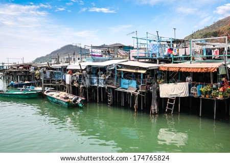 Hong Kong - April 10: Tai O residents go about their daily lives in their interconnected stilts houses above the tidal flats of Lantau Island, Hong Kong, April 10, 2011. Tai O is a fishing village.