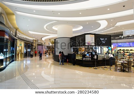 HONG KONG - APRIL 23, 2015: The PopCorn Shopping Malll interior. Hong Kong shopping malls are some of the biggest and most impressive in the world. - stock photo