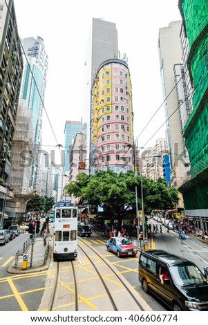 HONG KONG - April 3, 2016 : Urban day life in central district with tramways (Ding Ding car,famous tram/bus), the populated areas and international business and financial center in Hong Kong(HK),China