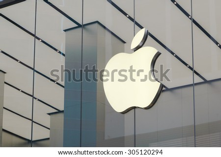 HONG KONG - AUG 10, 2015: Apple Sign Close Up. Is an American corporation headquartered in Cupertino that designs and sells consumer electronics, computer software and personal computers. - stock photo