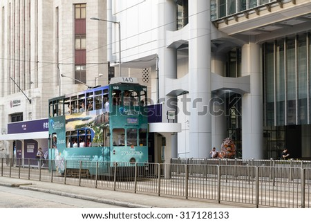 HONG KONG - AUG 11: Double-decker trams. Trams also a major tourist attraction and one of the most environmentally friendly ways of travelling in Hong Kong on August 11, 2015 in Hong Kong