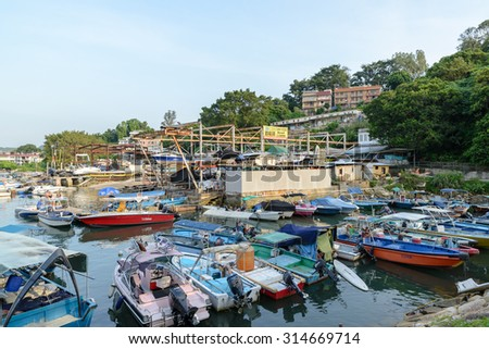 HONG KONG - AUG 29: Junks park at harbor in Sai Kung, Hong Kong on August 29 2014. Sai Kung is a typhoon shelter, where motorized junks used in the local tourist trade now are moored.