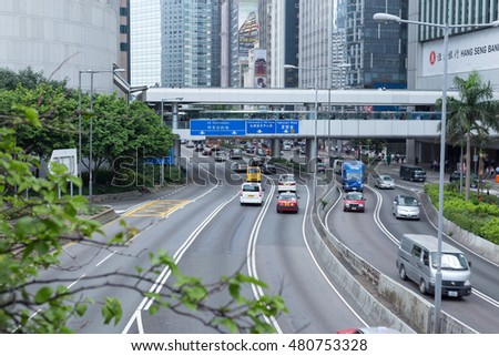 HONG KONG - AUGUST 04: Road in the city with tree foreground  August 04, 2015 at Hong Kong.