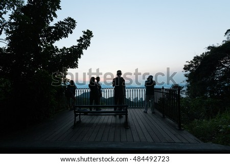 HONG KONG - AUGUST 04: sunset with silhouette tourists and photographer, The Peak August 04, 2015 at Hong Kong.