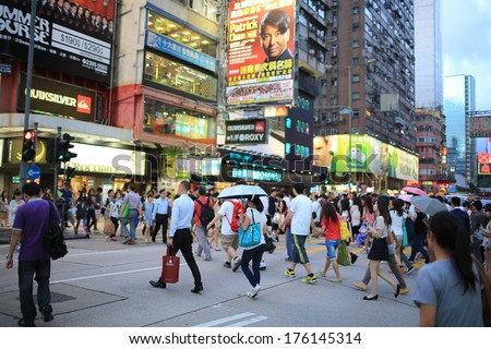 HONG KONG, AUGUST 26: the pedestrians walk through the road at Mongkok in HongKong on 26 august 2013.HK government call off the pedestrian zone in mong kok because complains for the crowded people