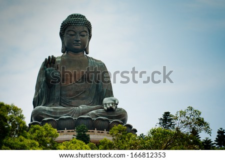 HONG KONG - AUGUST 29: Tian Tan Buddha on Lantau Island in Hong Kong on August 29, 2013. It is 34 meters tall and is a major centre of Buddhism in Hong Kong, it is also a popular tourist attraction