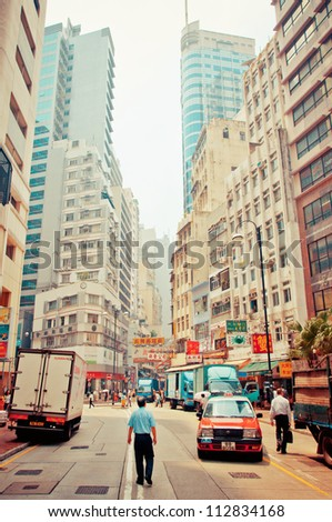 HONG KONG - AUGUST 01: view on downtown street on July 30, 2012 in Hong Kong. With a land mass of 1,104 km and 7 million people, Hong Kong is one of the most populated areas in the world - stock photo