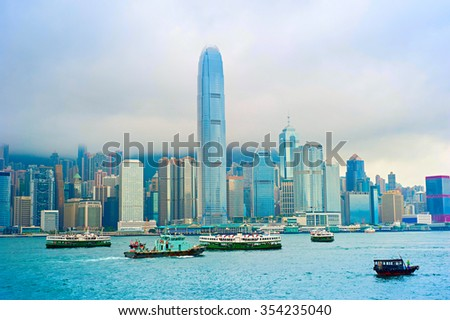 Hong Kong bay with many different ships and rainy clouds