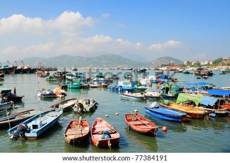 Hong Kong Cheung Chau island, colorfull fishing boats in harbor - stock photo