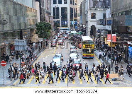 HONG KONG, CHINA - APR 13: Crowded street view on April 13, 2013 in Hong Kong, China. With 7M population and land mass of 1104 sq km, it is one of the most dense areas in the world. - stock photo