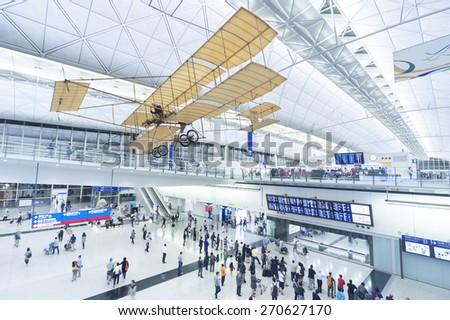 HONG KONG, CHINA - APRIL 16 : Arrival Hall in Hong Kong International Airport on April 16, 2015 in Hong Kong, China. It handles more than 70 million passengers per year.  - stock photo
