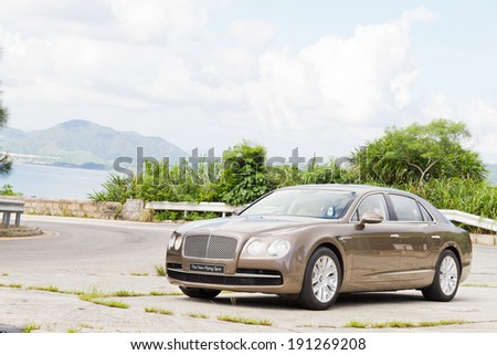 Hong Kong, China Aug 6, 2013 : Bentley The New Flying Spur 2013 Model test drive on Aug 6 2013 in Hong Kong. - stock photo