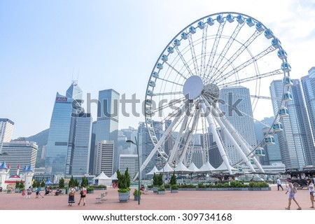 Hong Kong, China - AUG 25, 2015: Skyscrapers and Hong Kong Observation Wheel, which is the latest tourist attraction in the city.