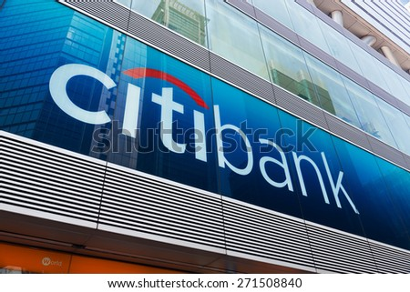 Hong Kong, China - August 13, 2011: Citibank sign and logo in front of the bank in Mongkok, Hong Kong, with reflection of financial buildings. Citibank is a major international bank.