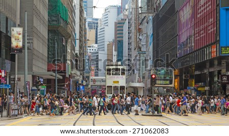 Hong Kong, China - August 21, 2011: Pedestrians crossing a busy crosswalk in Central, Hong Kong.
