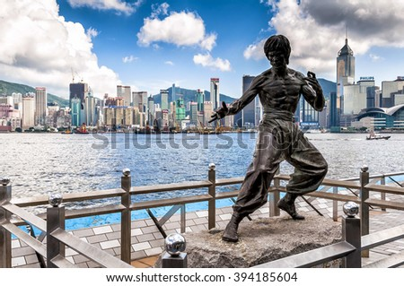 Hong Kong, China - August 22, 2011: The Bruce Lee memorial in Avenue of Stars. The memorial, a 2.5 metre bronze statue, was built on behalf of Bruce Lee, who died on 20 July 1973 at the age of 32.  - stock photo
